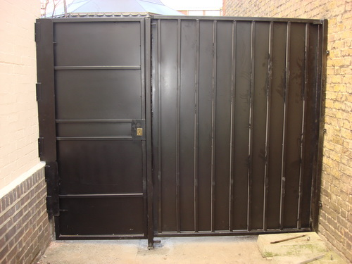 This is an external Bar Grille Gate, steel sheeted for privacy and security.