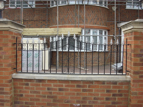 Thin green wrought iron railings
